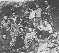 female partisan in a group of male partisans in the mountains
